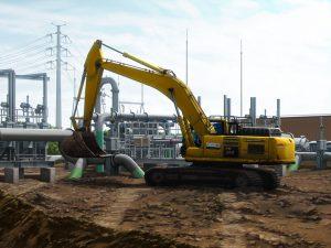 heavy equipment excavator in energy pipeline construction scene