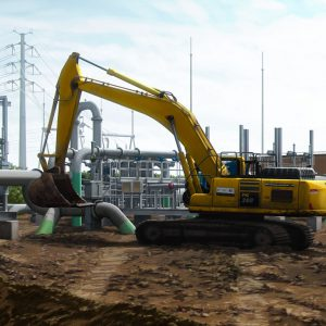 Heavy Equipment Excavator In Energy Pipeline Construction Scene Power Station Pipe Coating Corrosion Protection